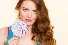 Woman joyful girl with lollipop candy Royalty Free Stock Images