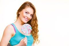 Woman joyful girl with lollipop candy Stock Image