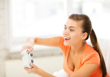 Woman with joystick playing video games Stock Photography