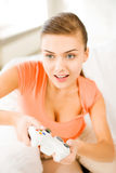 Woman with joystick playing video games Royalty Free Stock Images