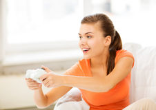 Woman with joystick playing video games Royalty Free Stock Image