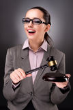 The woman judge with gavel in justice concept. Woman judge with gavel in justice concept Stock Photo