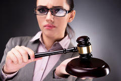 The woman judge with gavel in justice concept. Woman judge with gavel in justice concept Stock Photography