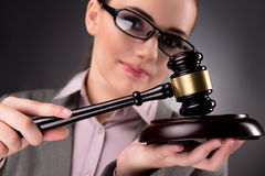The woman judge with gavel in justice concept. Woman judge with gavel in justice concept Stock Images