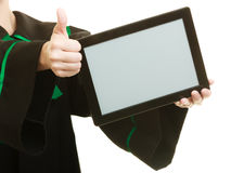 Woman judge with tablet. Showing thumbs up Stock Photography