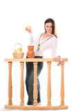 Woman with jug and apples Stock Photography
