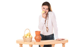 Woman with jug and apples Royalty Free Stock Images