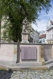 Woman with jug fountain in Bratislava Stock Image