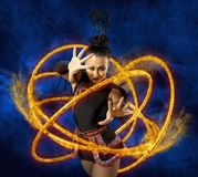 Woman juggler carries out show with hoops. Elegance woman juggler carries out show with hoops Stock Photo