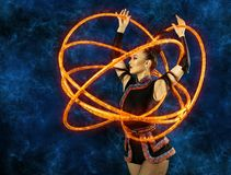 Woman juggler carries out show with hoops. Elegance woman juggler carries out show with hoops Stock Photography