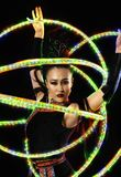 Woman juggler carries out show with hoops. Elegance woman juggler carries out show with hoops Stock Images