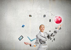 Woman juggler. Young pretty businesswoman juggling with white balls Royalty Free Stock Image
