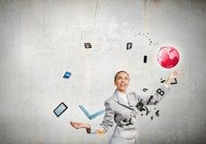 Woman juggler Royalty Free Stock Image