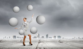 Woman juggler Stock Photo