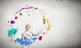Woman juggler Stock Images