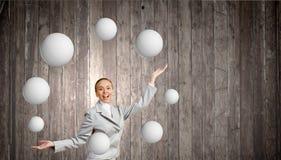 Woman juggler Stock Photography