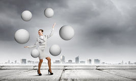 Woman juggler Royalty Free Stock Photo