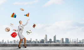 Woman juggler Royalty Free Stock Image