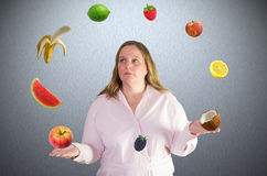 Woman juggles with fruit Stock Photography