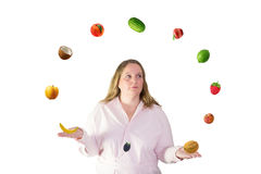 Woman juggles with fruit Royalty Free Stock Photo