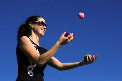 Woman Juggling Balls Stock Images