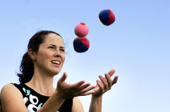 Woman Juggling Balls Stock Photo