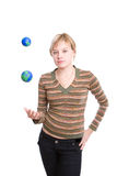 Woman juggling earths Stock Image