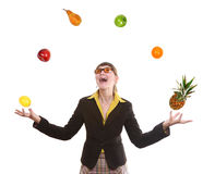 Woman juggling fruit Stock Images