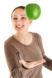 Woman juggling with green apple stock photos