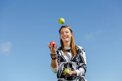 Woman juggling with healthy apples Stock Photo