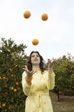 Woman Juggling Oranges Stock Photography