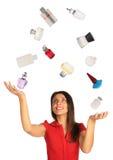 Woman  juggling perfumes collage. Woman looking up and juggling perfumes collage Stock Image