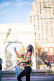 Woman Juggling with Pins, in the Middle of Greenwich Park in New Stock Photo
