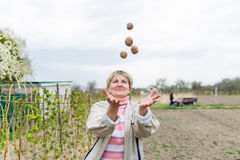 Woman juggling with potato Royalty Free Stock Photography