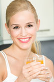 Woman with juice Stock Photos