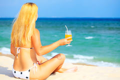 Woman with juice Royalty Free Stock Image