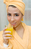 Woman with juice Stock Image