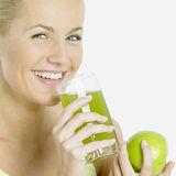 Woman with  juice Royalty Free Stock Photos
