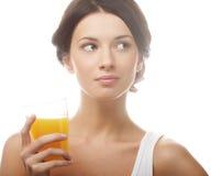 Woman juice glass . Royalty Free Stock Image