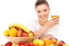 Woman with juice Royalty Free Stock Images