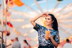 Woman with Juice on Spinning Ferris Wheel Background stock images