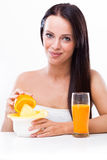 Woman with a juicer and oranges Royalty Free Stock Photo