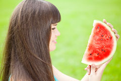 Woman with juicy watermelon in hands Stock Photos