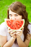 Woman with juicy watermelon in hands Stock Images