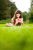 Woman with juicy watermelon in hands Stock Photography