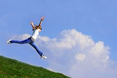 Woman jump. In sky...moment of happiness royalty free stock photo
