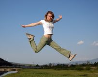 Woman jump Stock Images