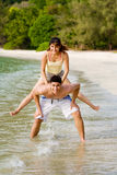 Woman jump from the back of a guy Stock Photo