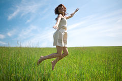 Woman jump in field Stock Photo