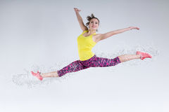 Woman in jump. Frozen motion. Stock Photo